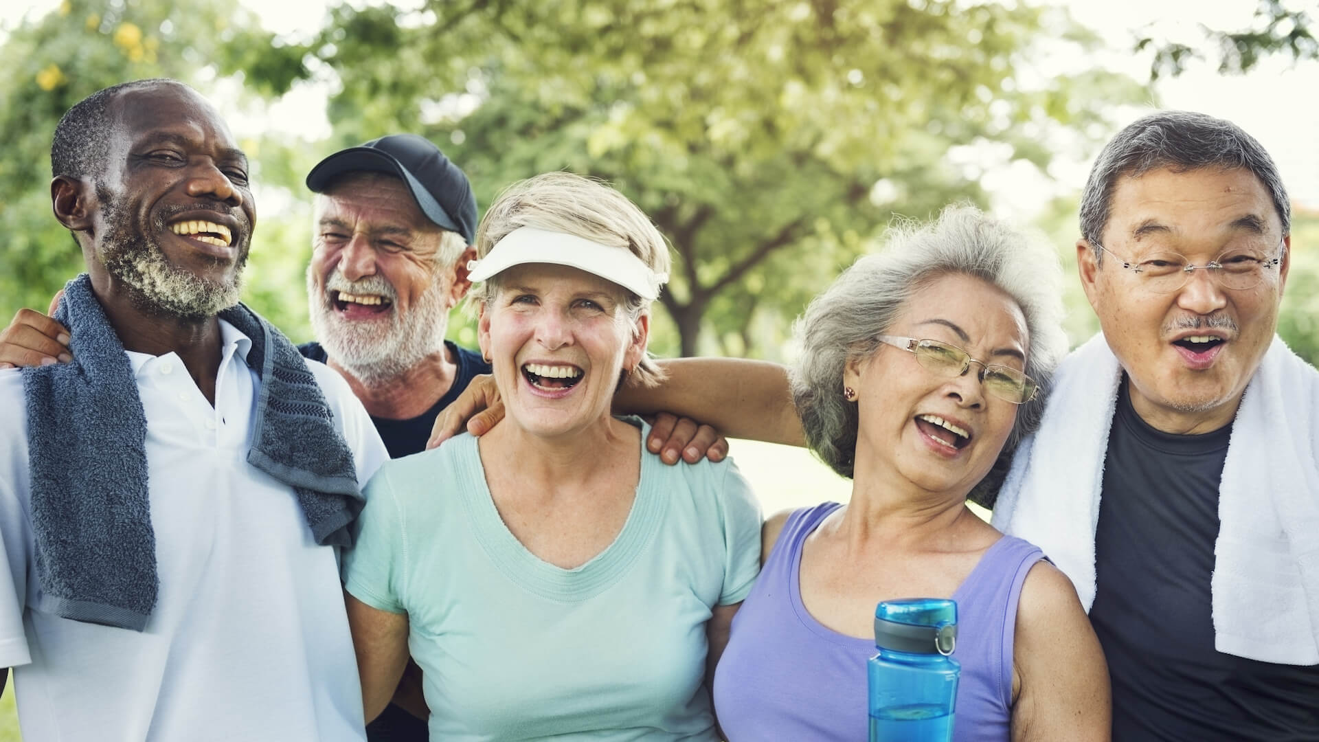 Group of senior friends exercise together