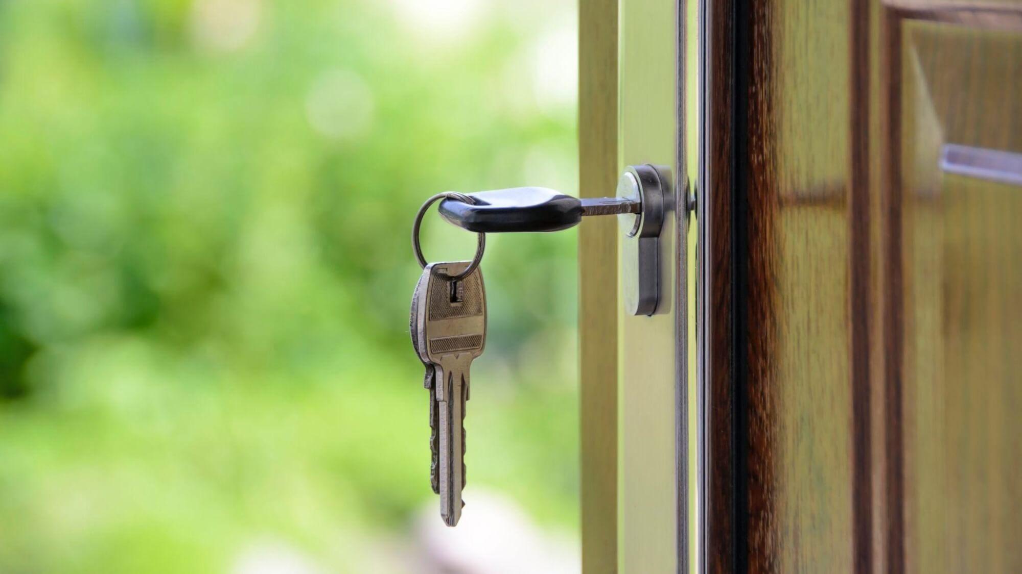 Set of keys unlocking front door of house