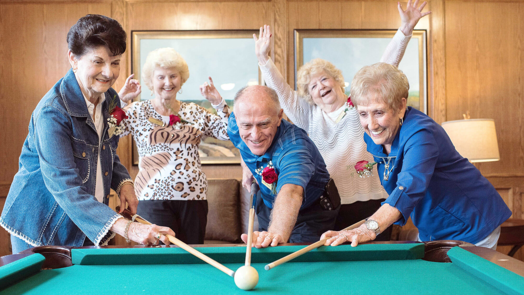 Residents playing pool and having a blast at Ashwood Square