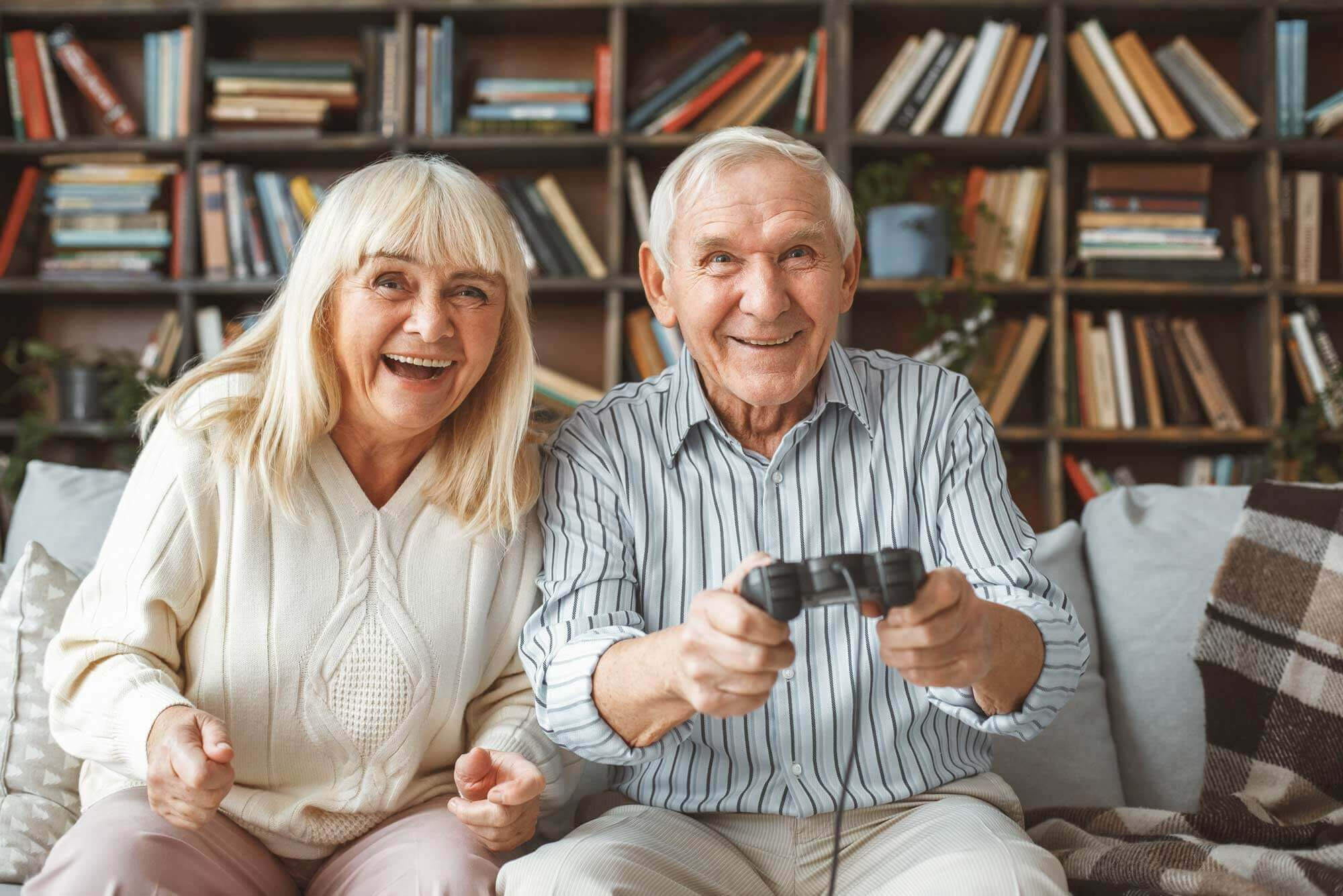 senior couple has fun playing video games together
