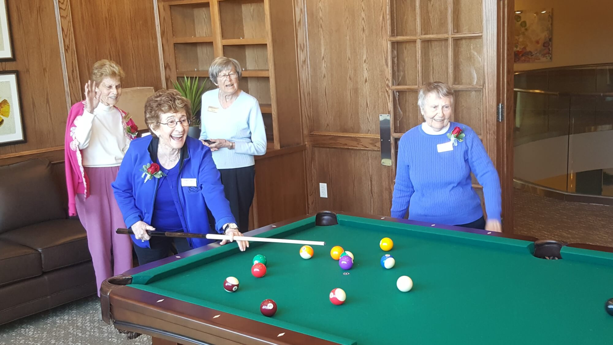 residents playing pool in Bradford Square's billiards room