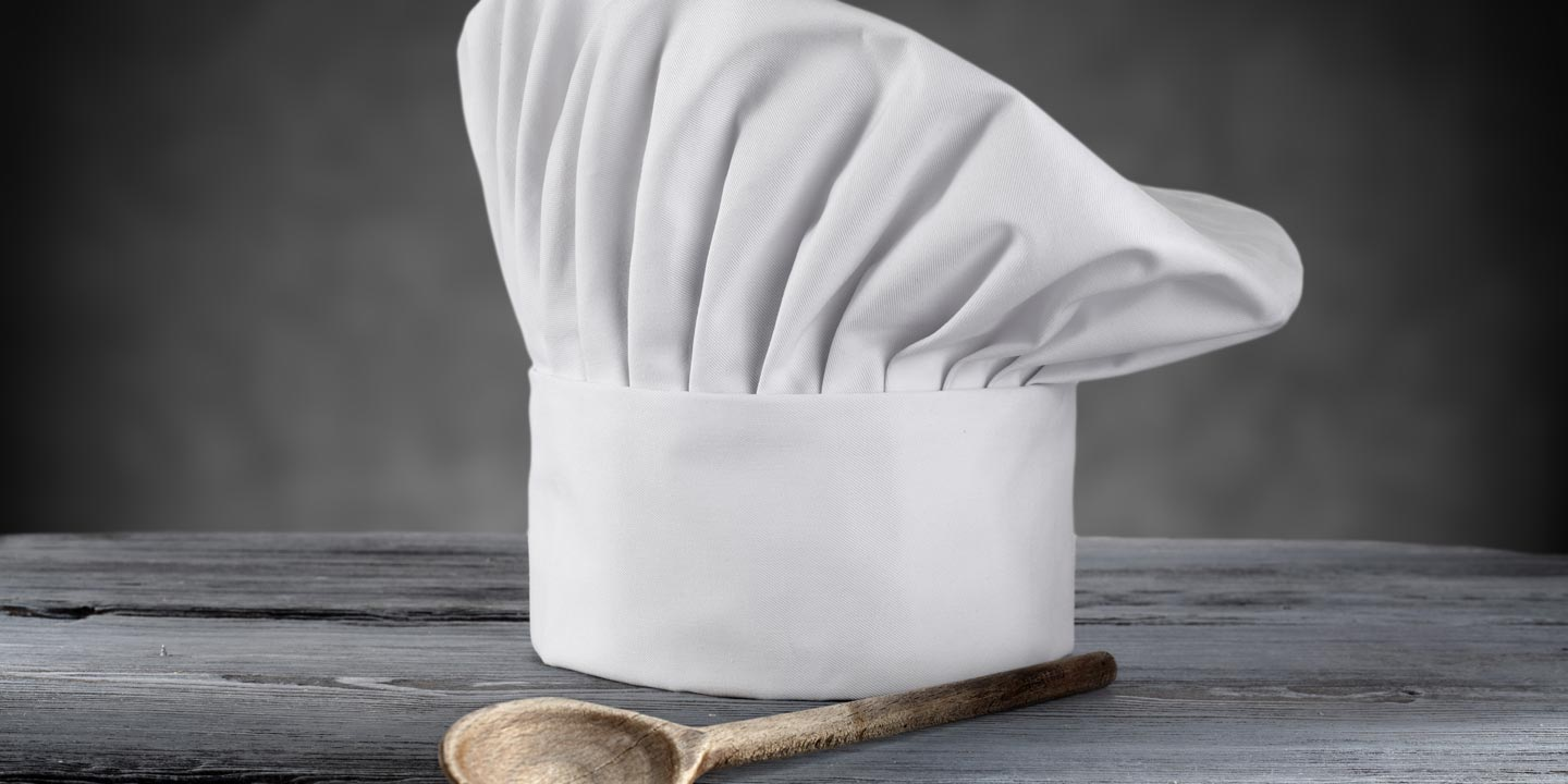 A hat and serving spoon to represent the culinary team.