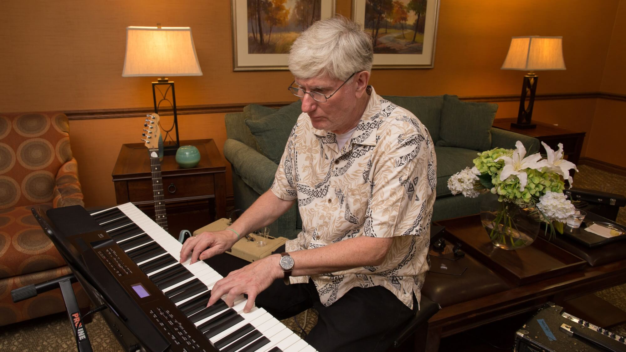 Resident plays the piano at Capital Oaks