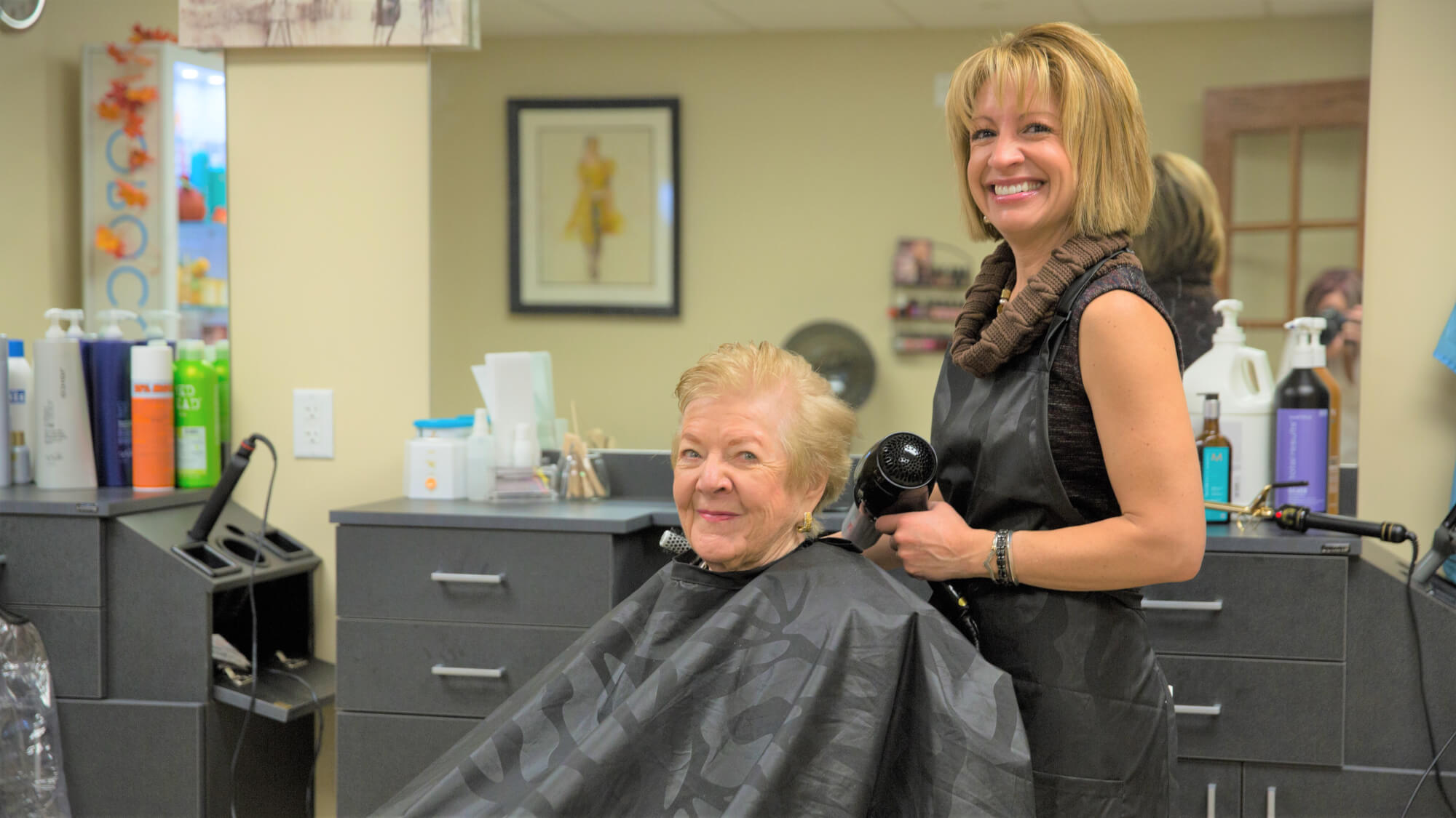 Resident getting her hair done in the full-service hair salon at Coronado Villa