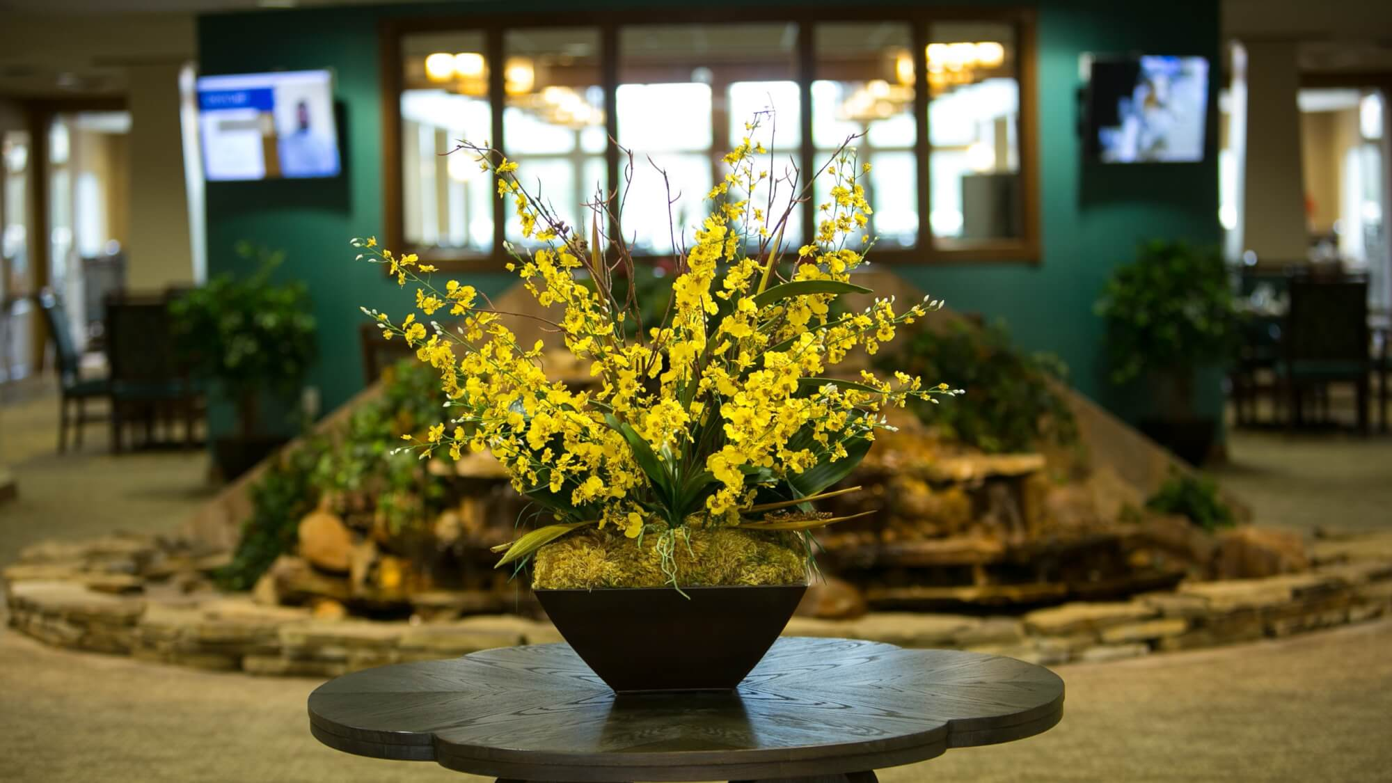 fresh farm flowers displayed in lobby at Emerald Oaks