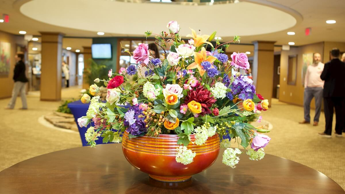 fresh farm flowers displayed in lobby at Huntley Springs