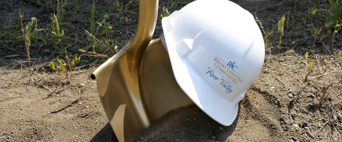 Golden shovel and Resort Lifestyle Communities hard hat to represent the construction being done at River Valley.