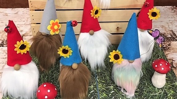 """Nothing brings joy and mental relaxation like working with your hands to create something special. At Maple Ridge (Omaha, NE), our residents and managers recently got together for an afternoon of crafting """"gnomes for your homes."""" Each gnome, unique with its own hat, beard, and accessories, will be displayed on our residents' front porches to share with the community, further spreading the happiness that art provides."""