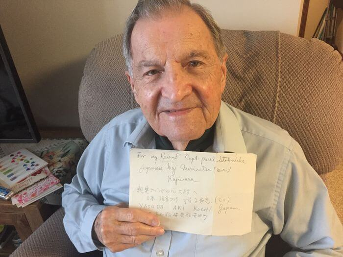 Dr. Paul Stobnicke, 96, holds a note he received from a former Japanese officer he befriended on Formosa (now Taiwan) just after World War II ended. Stobnicke lives at Towne Center Retirement Community in Fayetteville.