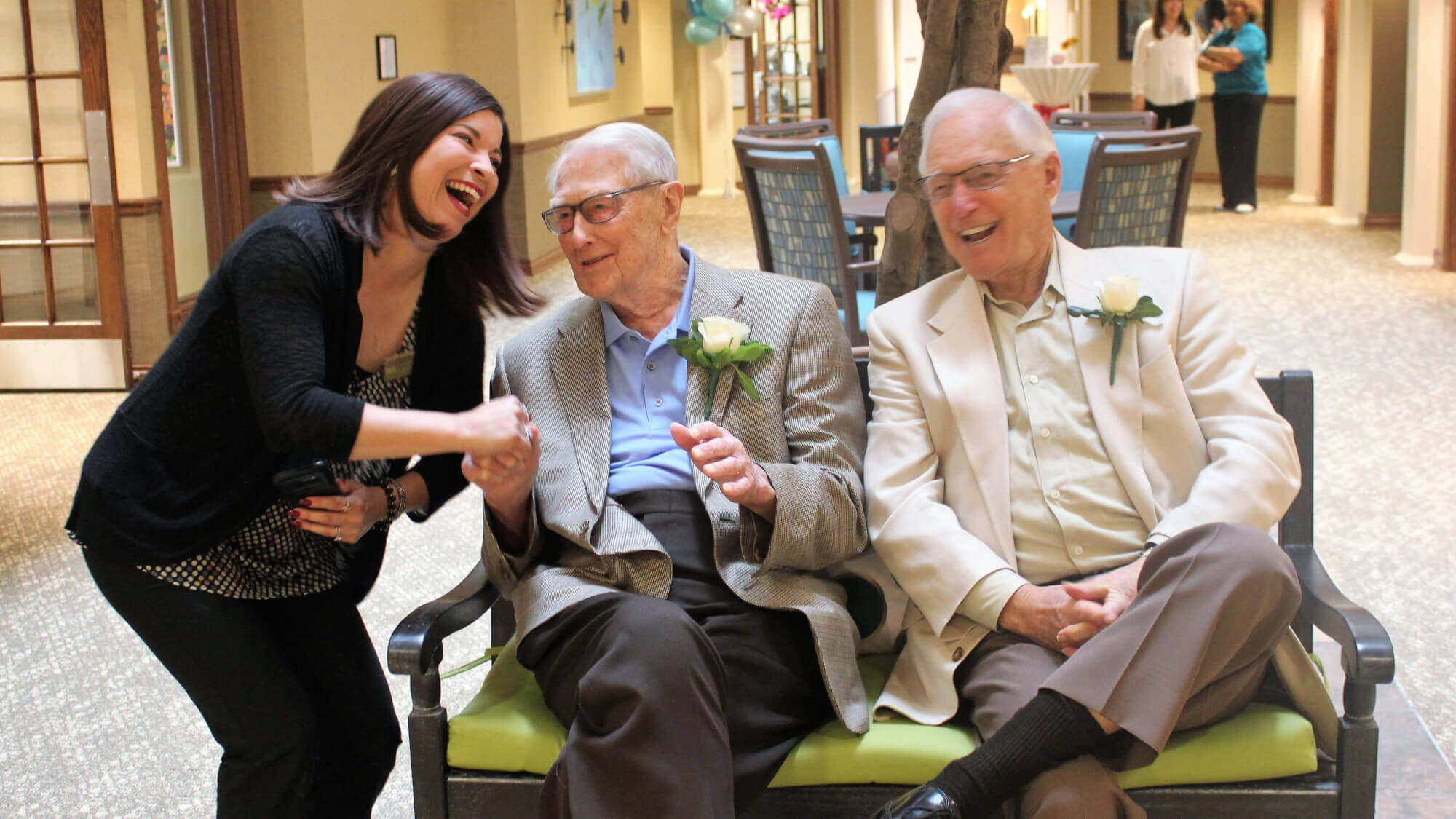 Residents share a laugh together with the Lifestyle Director on Main Street.