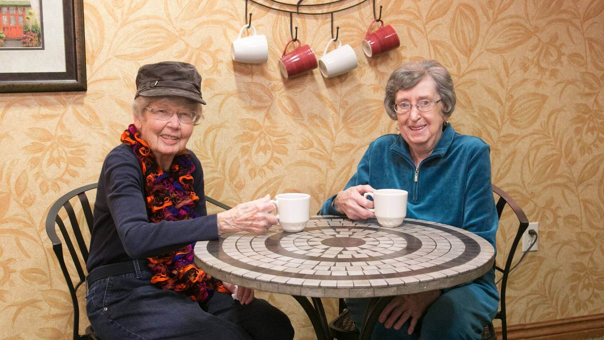 Friends enjoy a cup of coffee and conversation together in Maple Ridge's bistro.