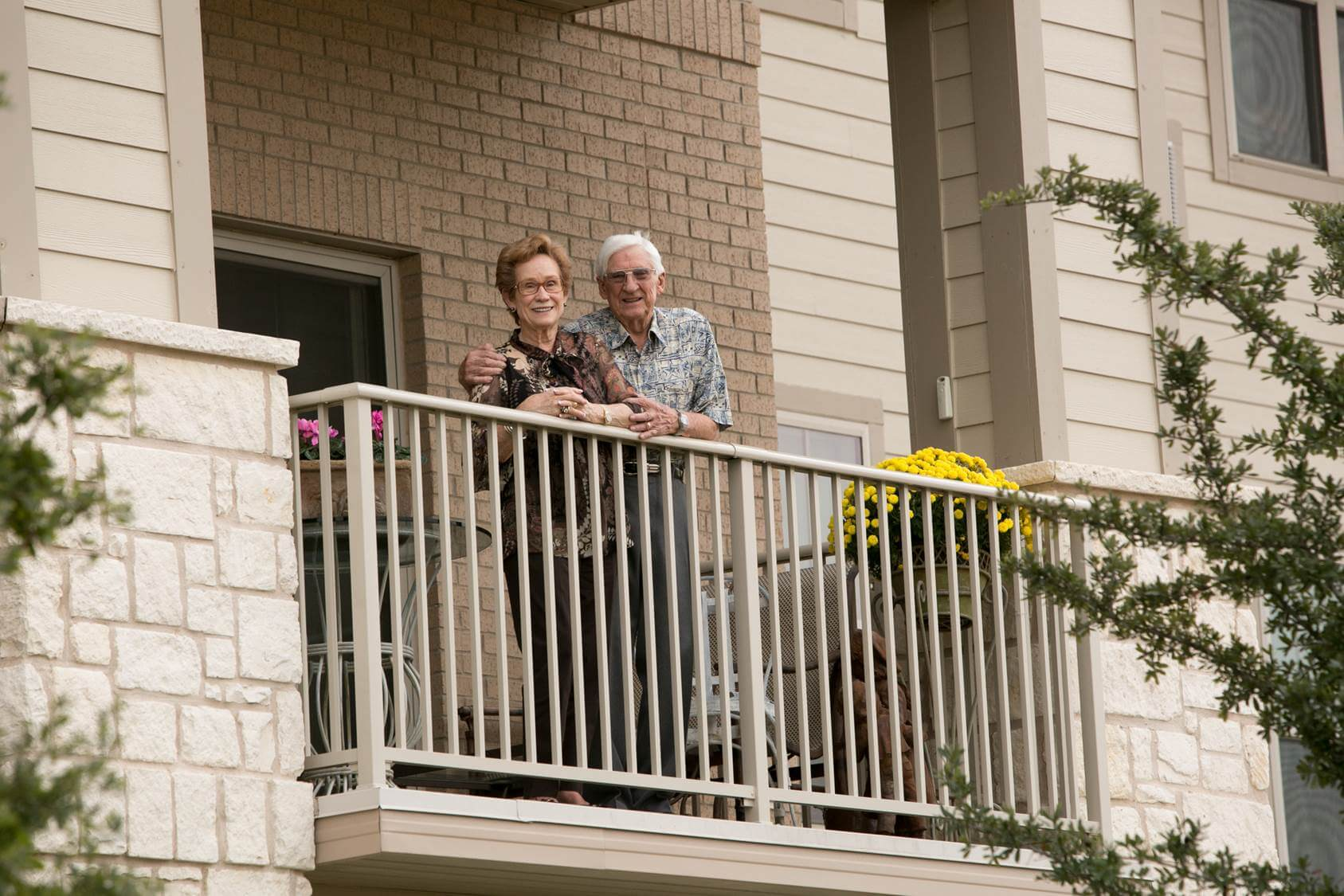 Senior couple standing on balcony