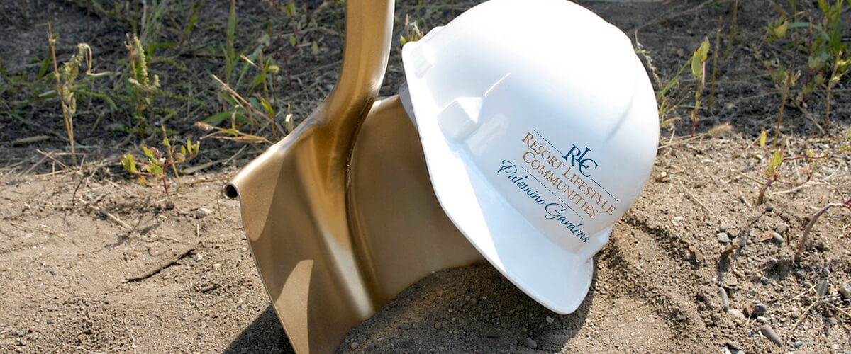 Golden shovel and Resort Lifestyle Communities hard hat to represent the construction being done at Palomino Garden.