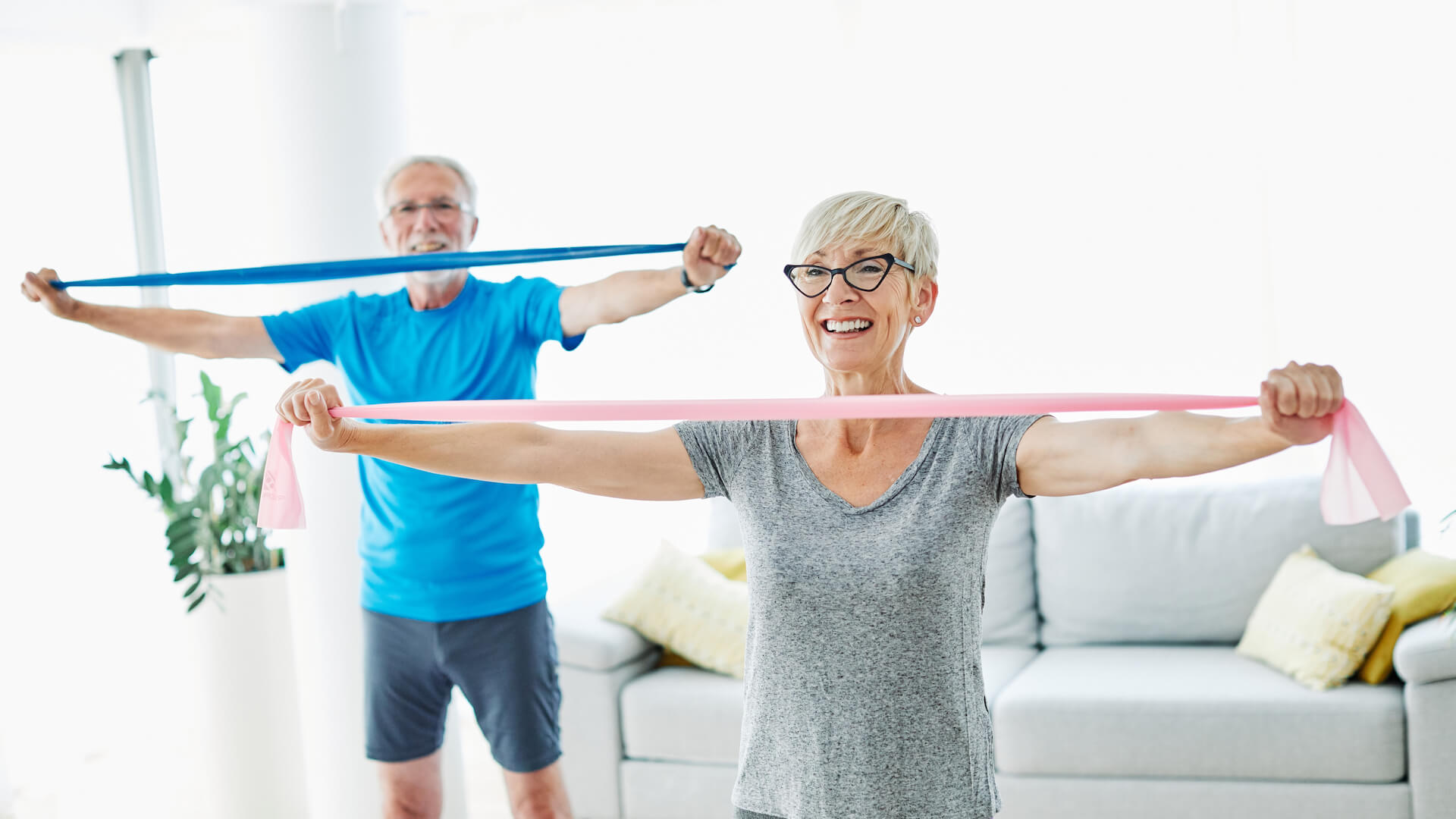 Senior couple exercise together at home health care