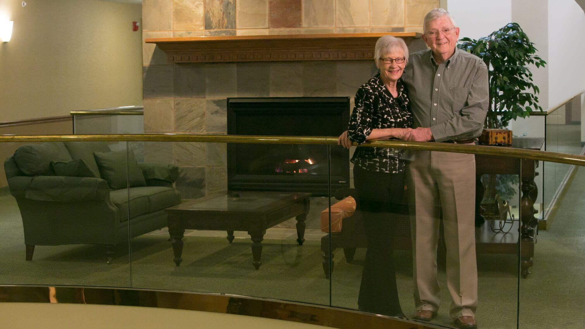 Happy senior couple standing together in Resort Lifestyle Communities.