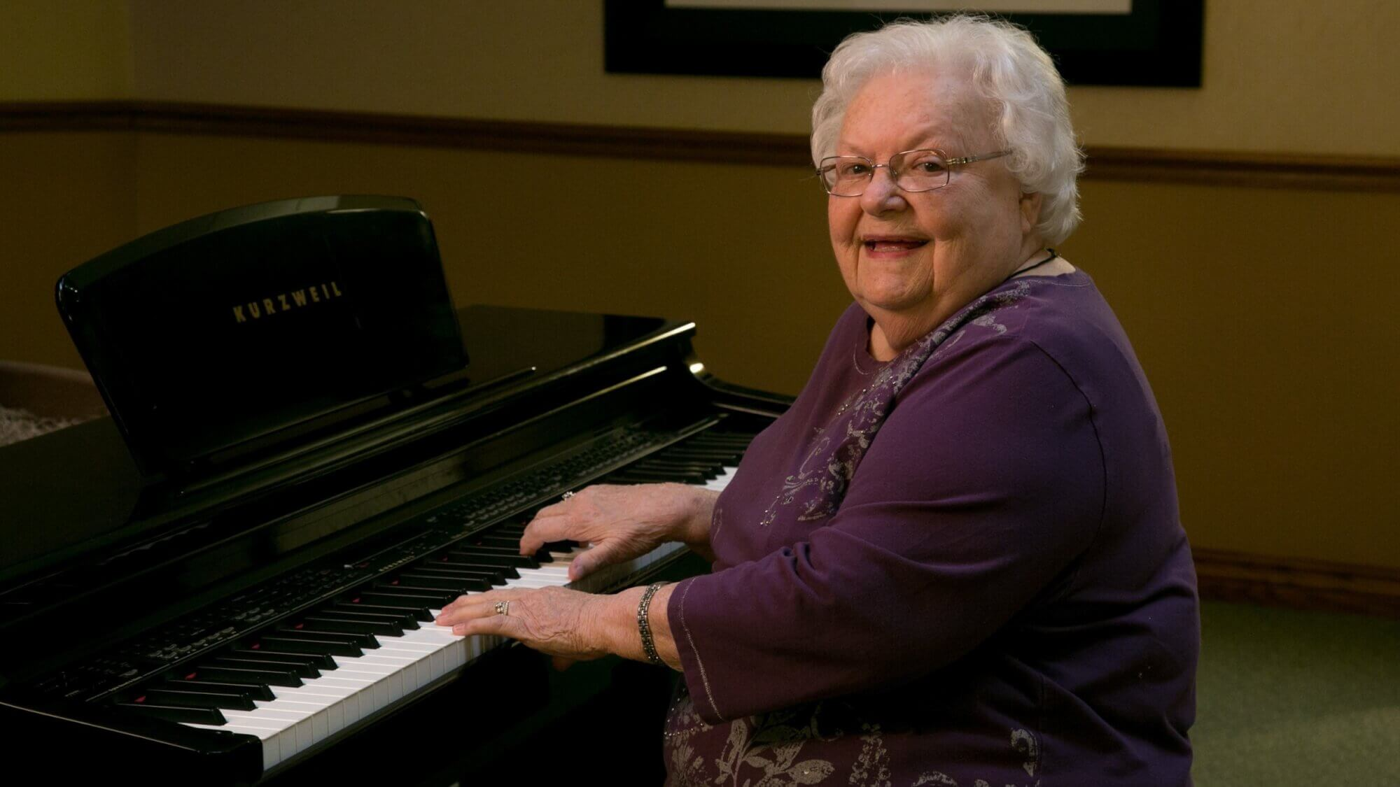 Happy senior enjoying playing piano.