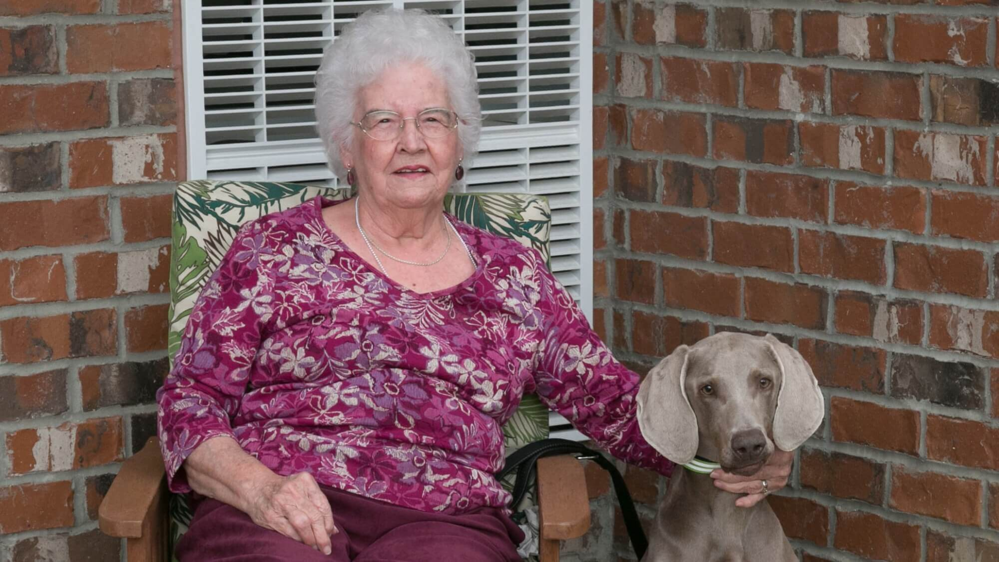 Happy senior with their dog