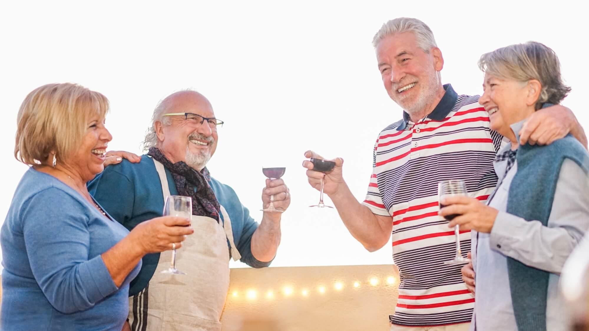 Senior couples drinking wine together having fun.