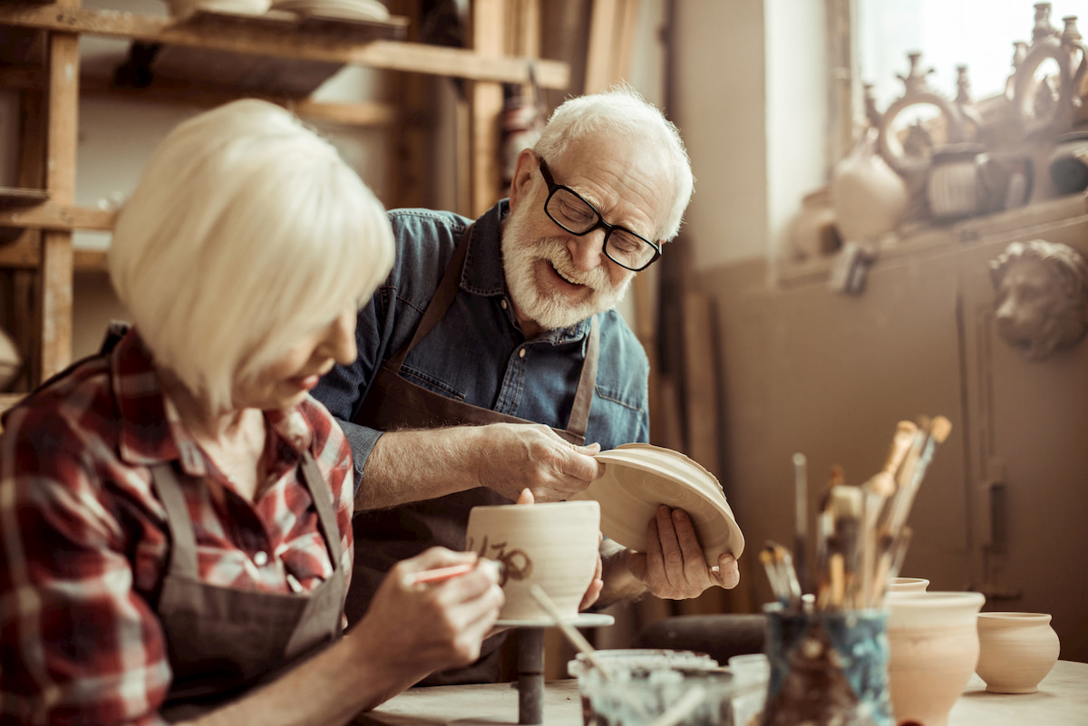 seniors doing pottery
