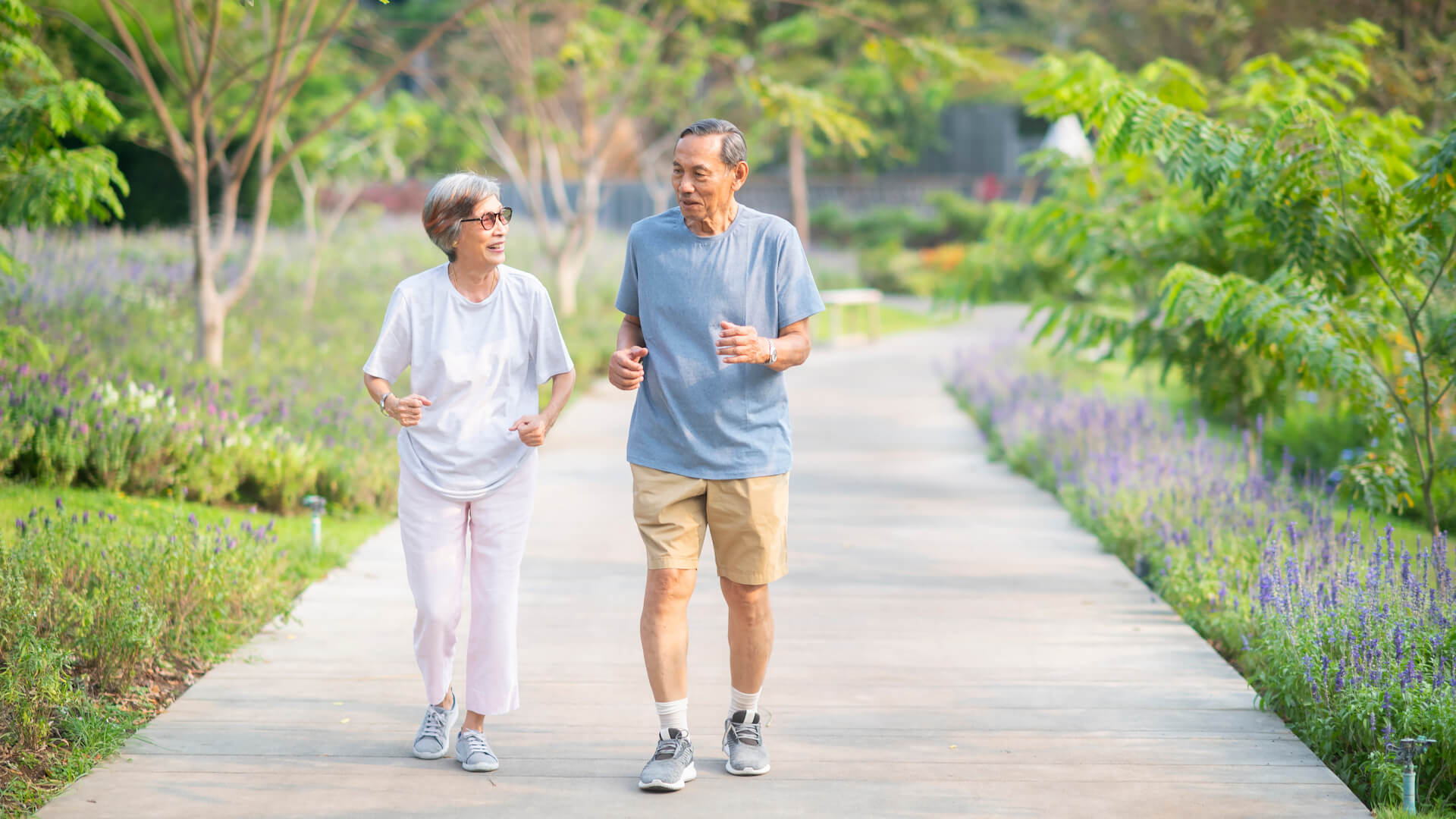 Asian senior retired couple jogging or exercise in the park. Healthy elderly people concept