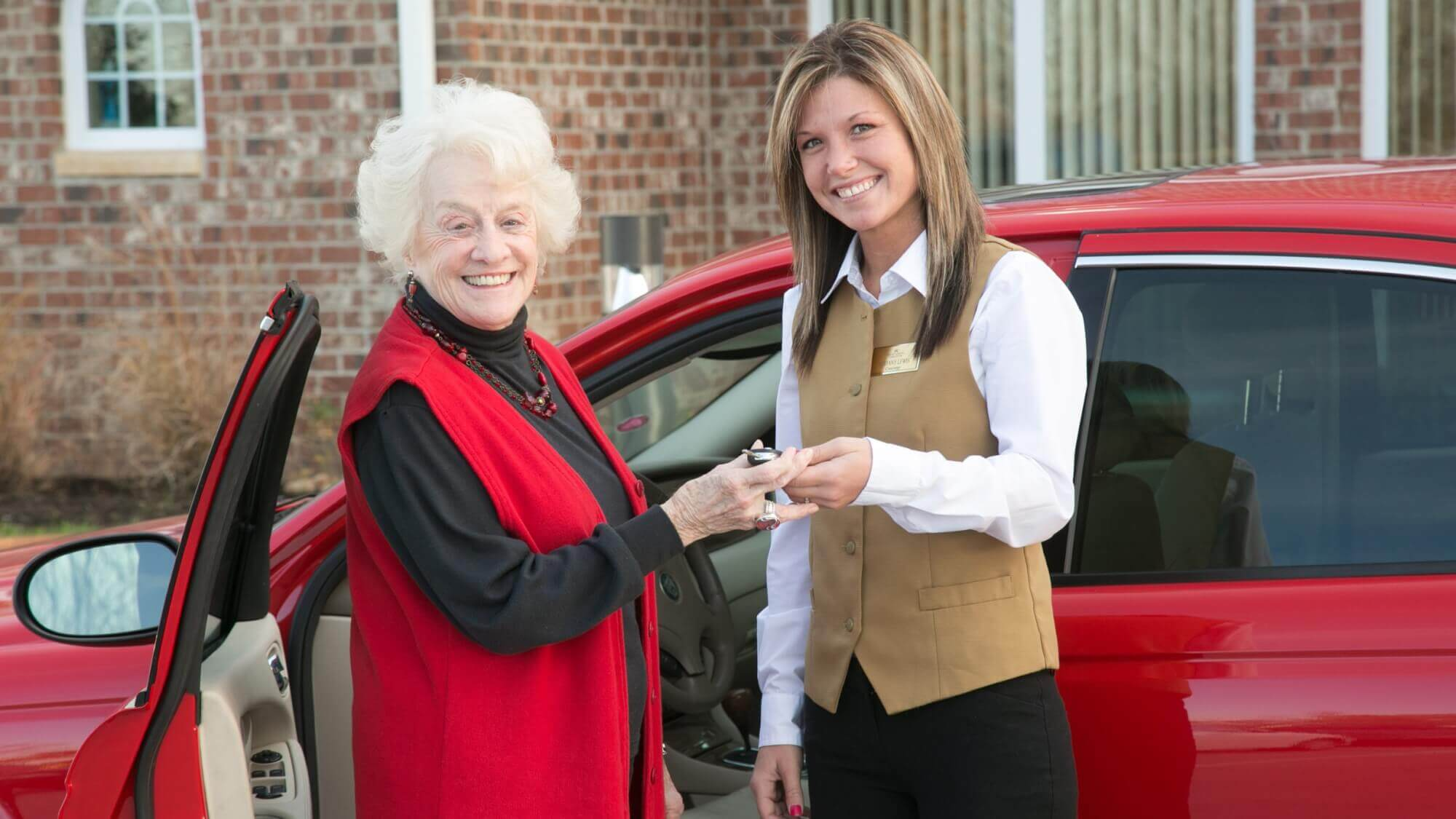 Senior receiving a valet from a Resort Lifestyle Communities employee.