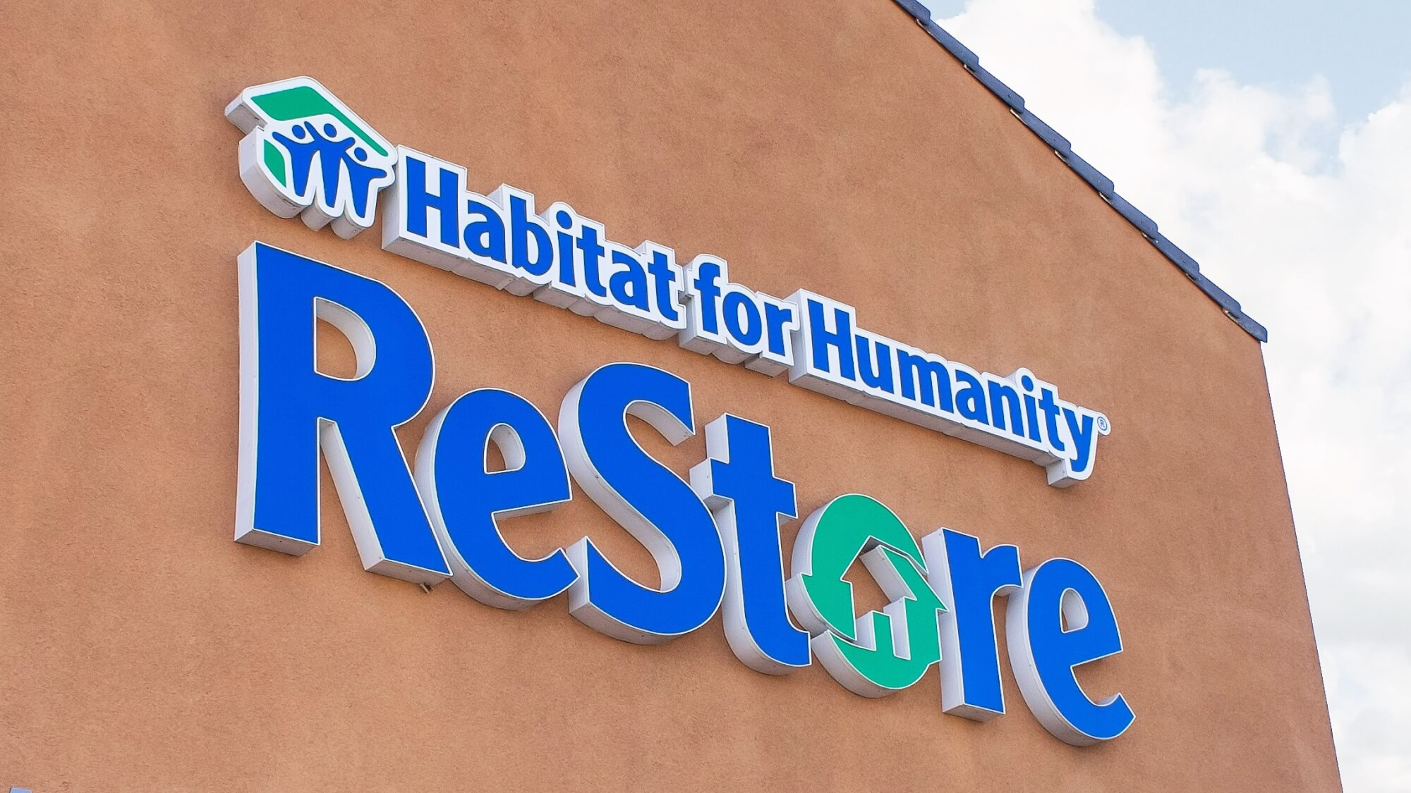 A store front sign for the home improvement thrift store chain known as Habitat for Humanity ReStore