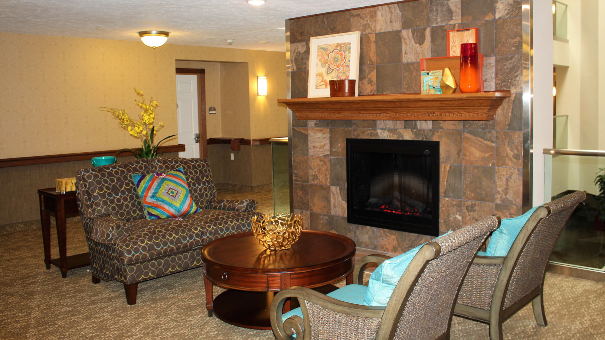 Cozy gathering spot in front of the fireplace at Towne Center.