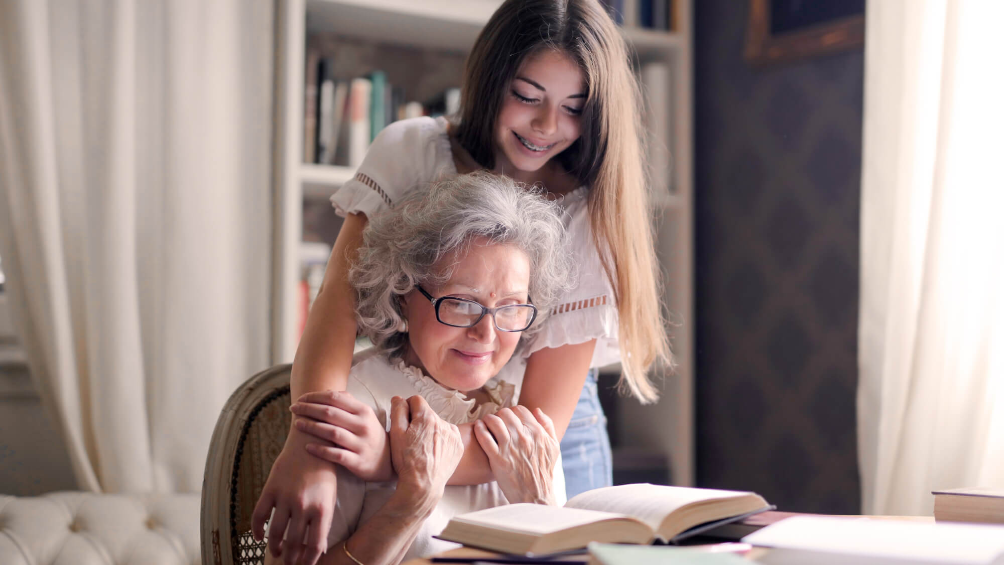 Grandma and granddaughter studying together