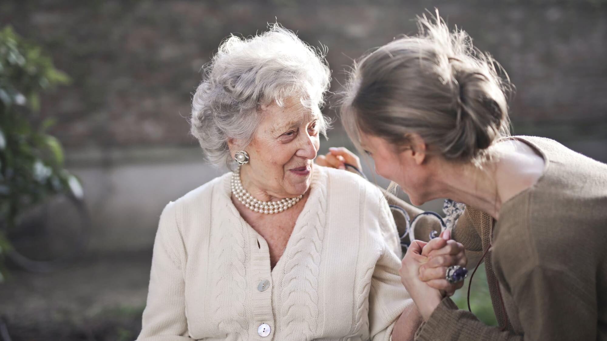 Daughter with elderly senior mother