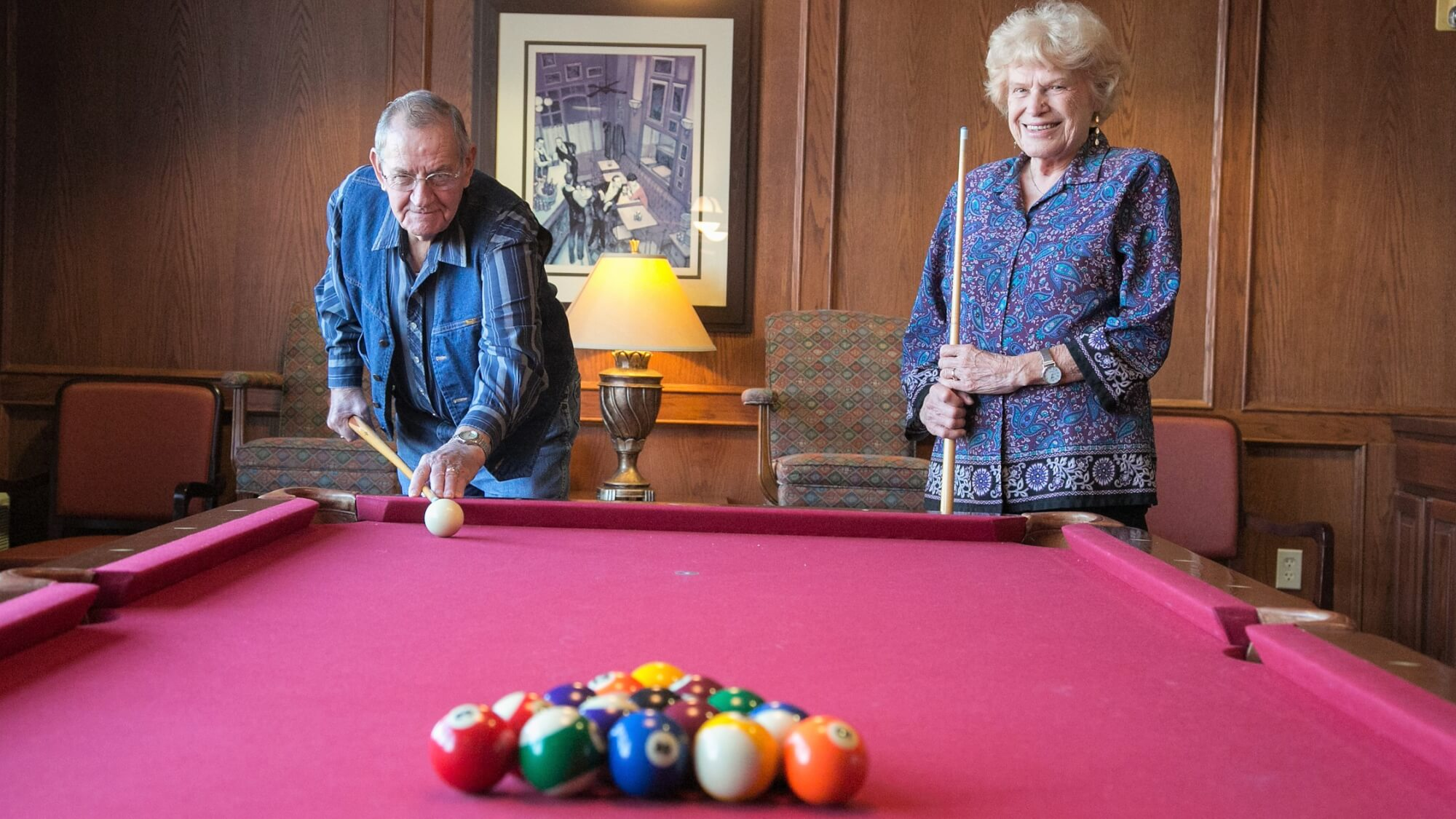 Playing pool in the billiards room is a great pastime at Walnut Grove.